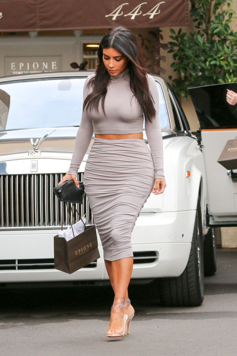 Kim Kardashian's clothes and her out-there sense of style give us more joy than most things in the world. See all of her latest outfits here including all of those nearly-naked dresses.